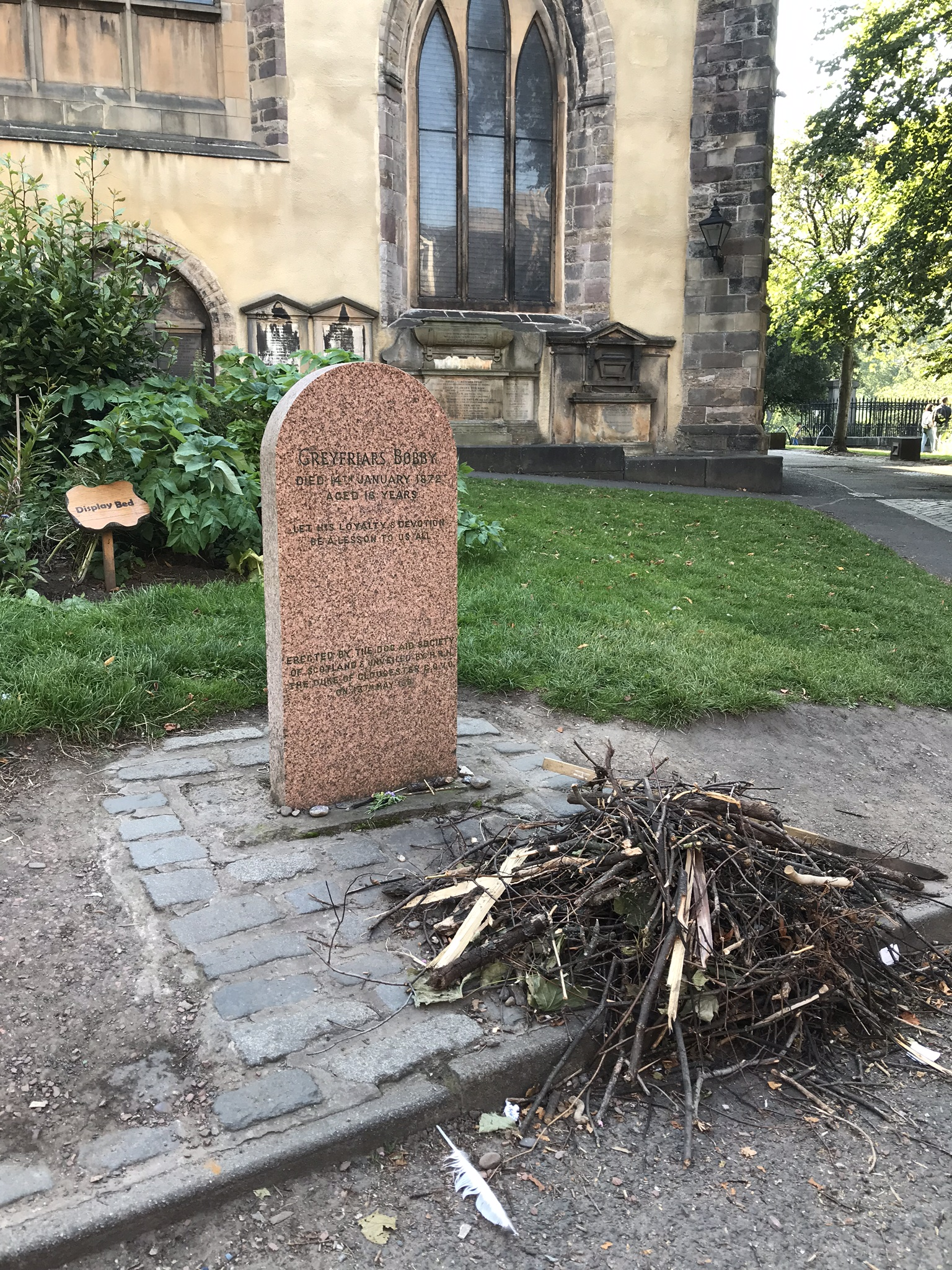 Pile of sticks on Greyfriars Bobby's grave