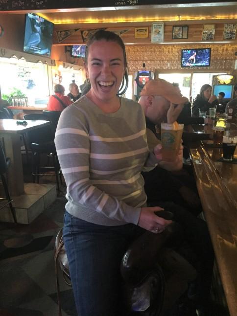 Enjoying a beer on horse saddle bar stool